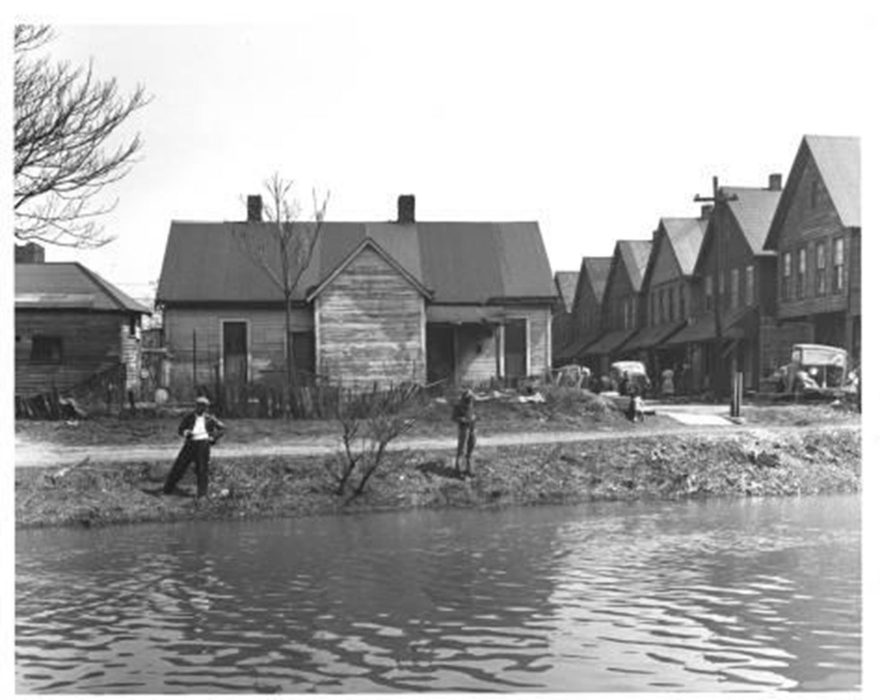 Men fishing along the canal (O. James Fox Collection, Indiana Historical Society)